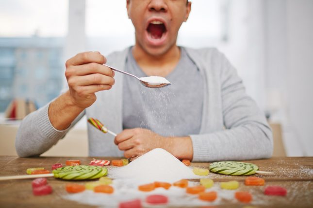 Man eating sugar