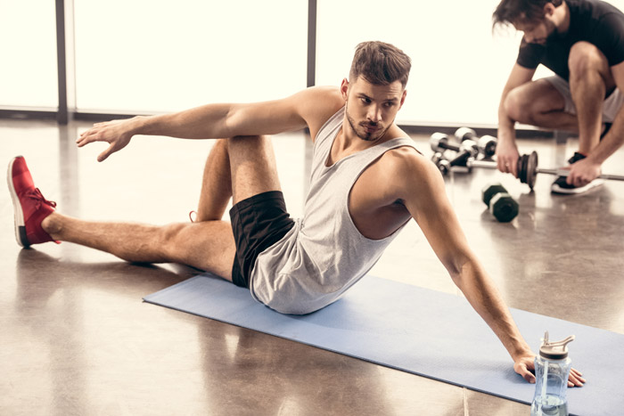 handsome sportsmen stretching on yoga